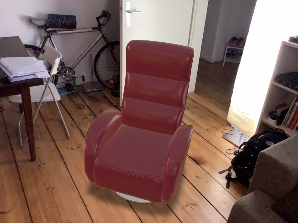 A 3D model of a chair positioned in Augmented Reality