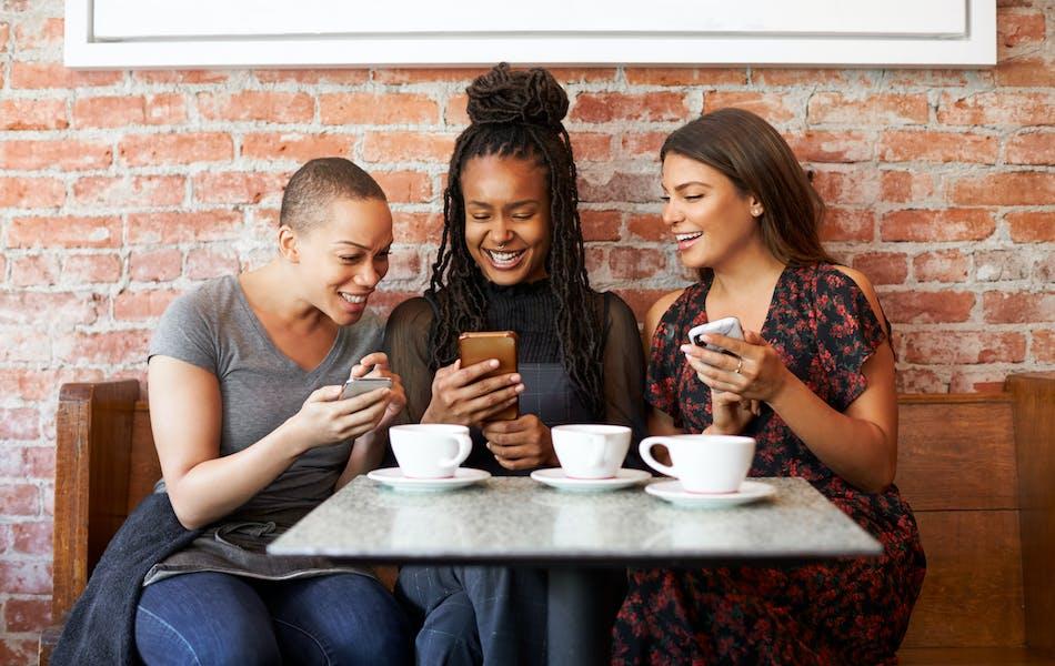Three friends drinking coffee