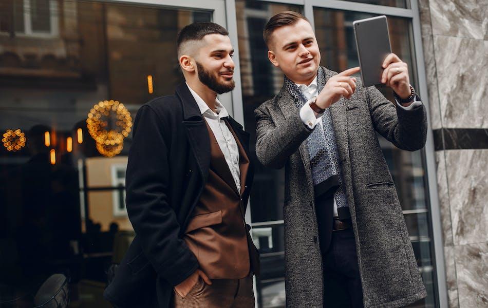 Two businessmen outside