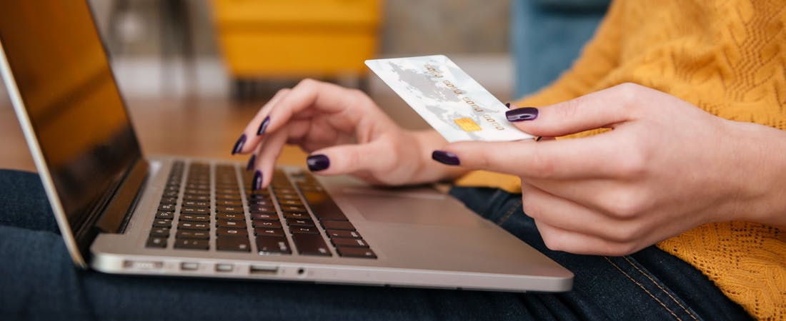 woman with a laptop and credit card