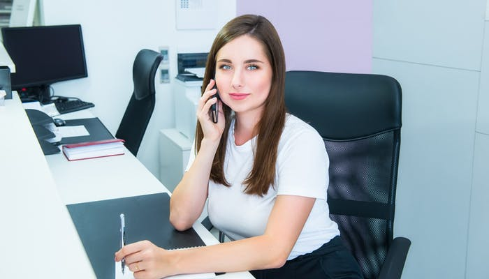 Woman in office on phone