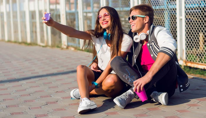 young people taking a photo for social media