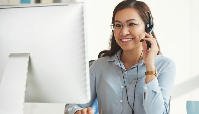 woman working in a collections job in a call centre