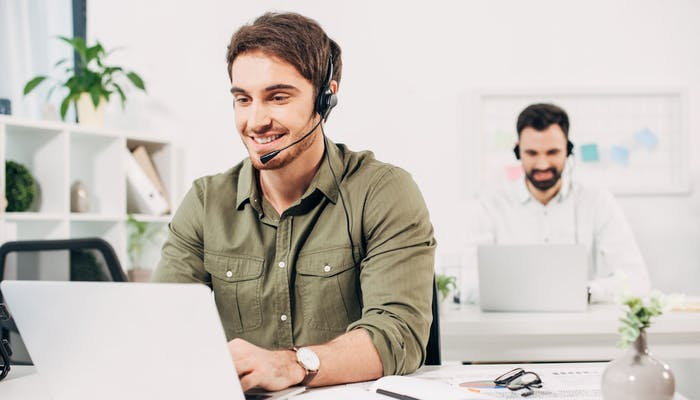 two men working in a call centre
