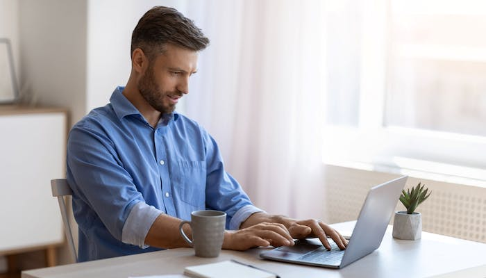 man looking at job listings on his laptop
