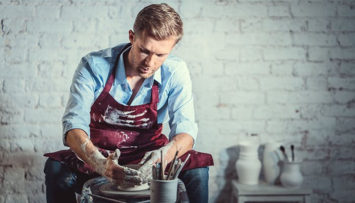 man at work in a pottery studio
