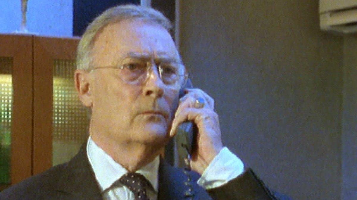 Closeup image of man on phone.