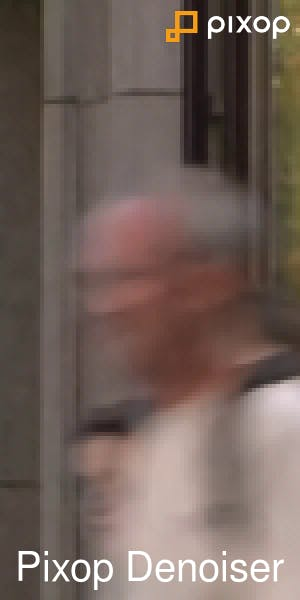 Blurry picture of man walking in the street