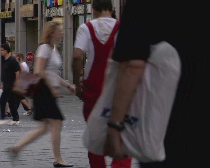 Pedestrians walking in the street.