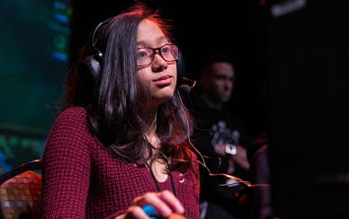 Girl with glasses playing a game