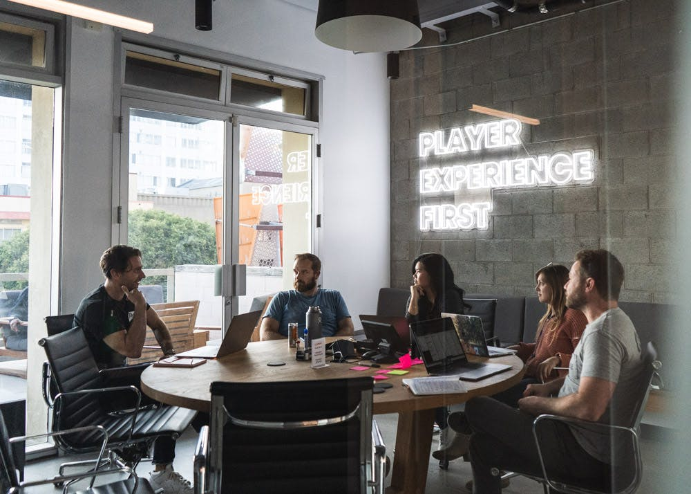 Group of employees sitting around a table having a meeting