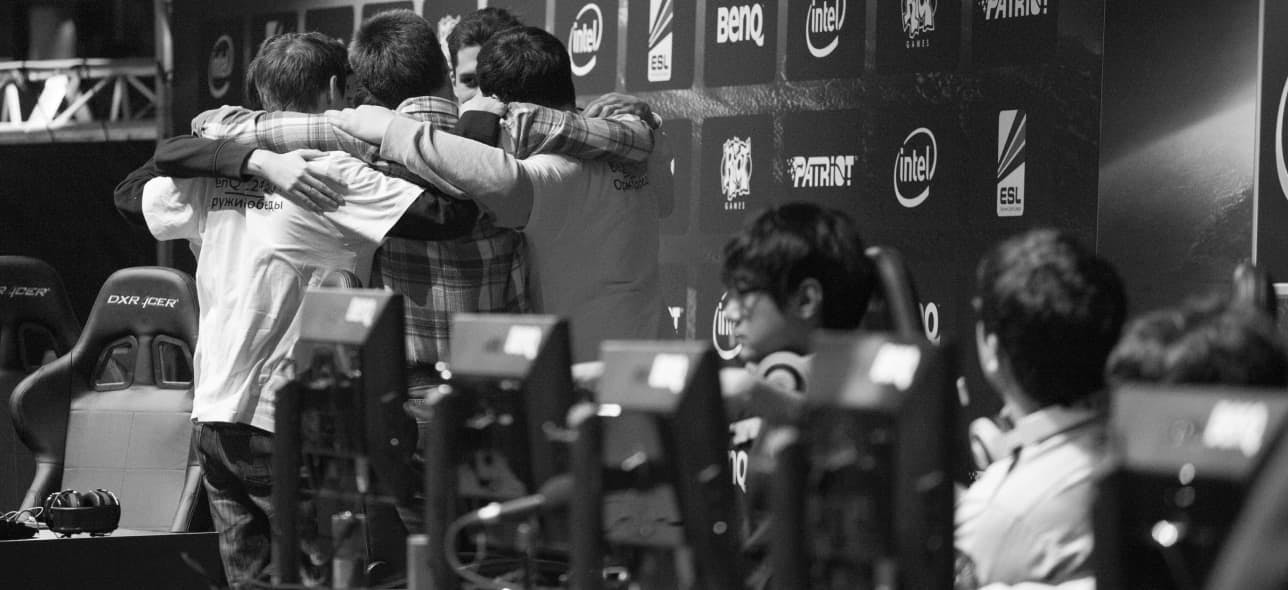 Esports team huddling together before a match begins