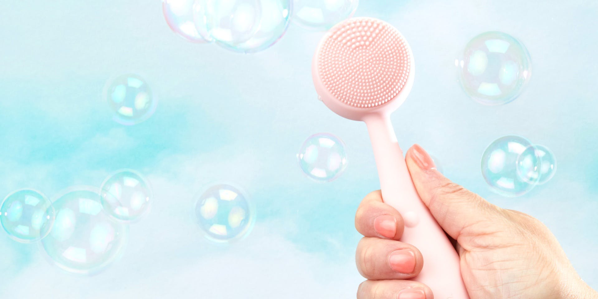 Woman holding PMD clean in hand with bubbles