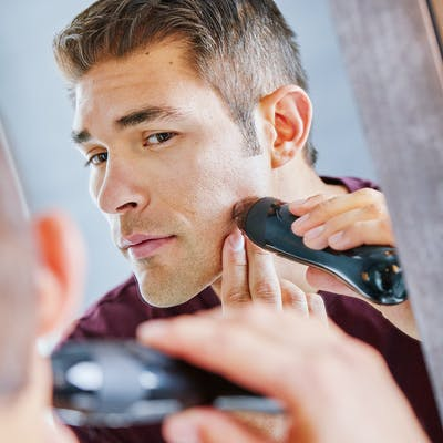 Man using Personal Microderm Elite on face
