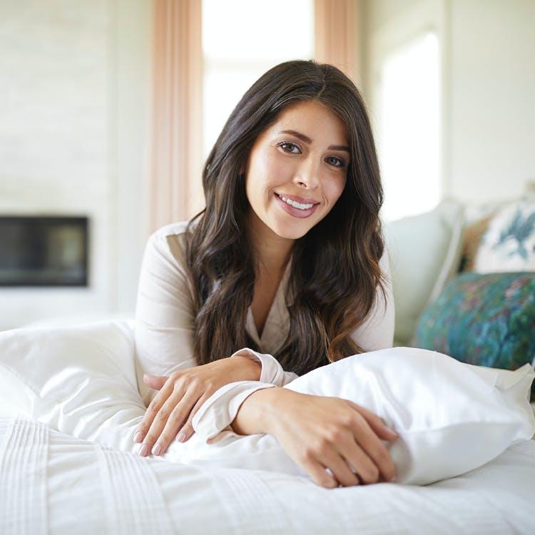 Woman with silversilk Pillowcase on bed
