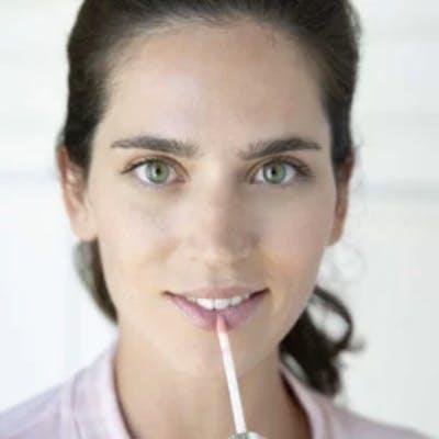 Woman with applying lip gloss