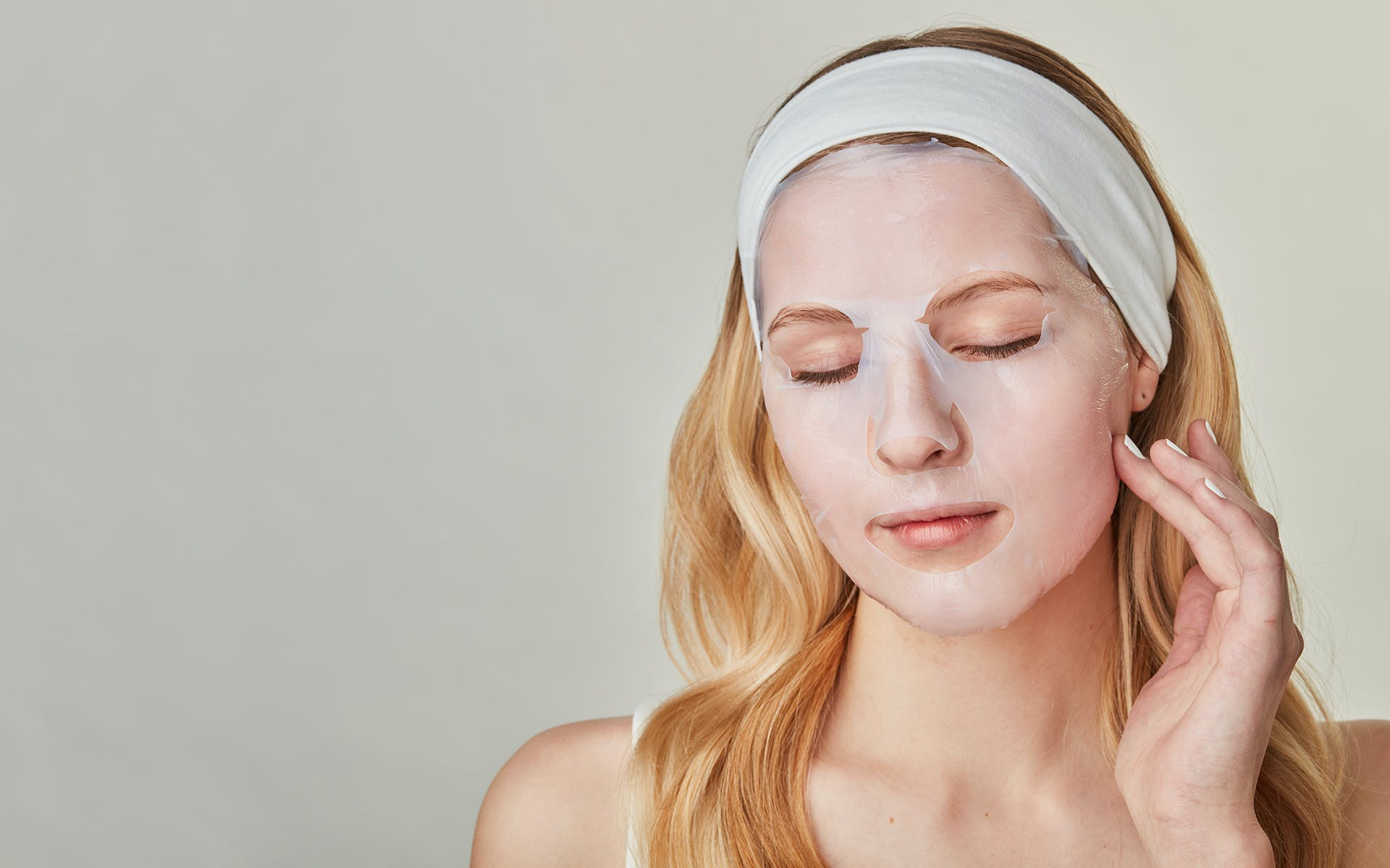 Woman with sheet mask on face