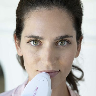 Woman using PMD Kiss System