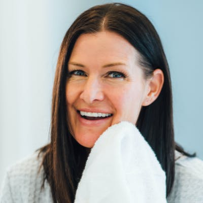 Woman patting face dry