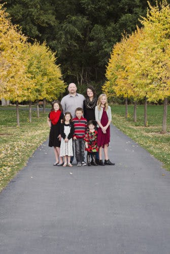 Family with trees in background