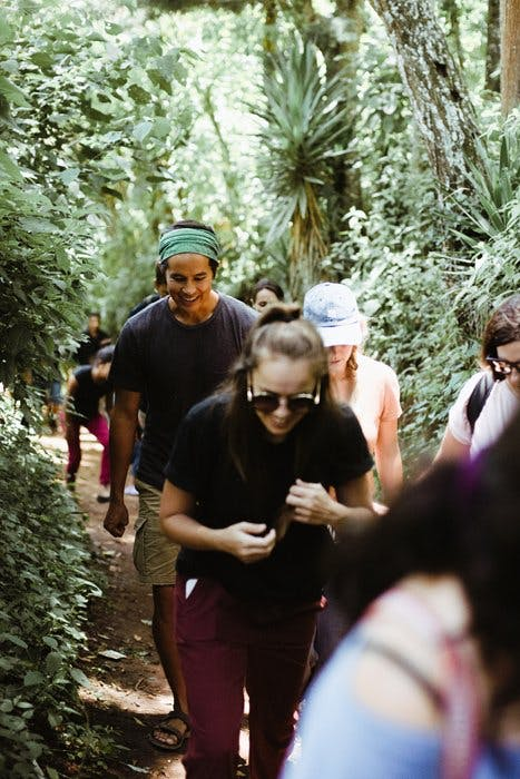 Natalie and The Bucket List Family walking through trees