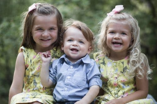 3 young children smiling