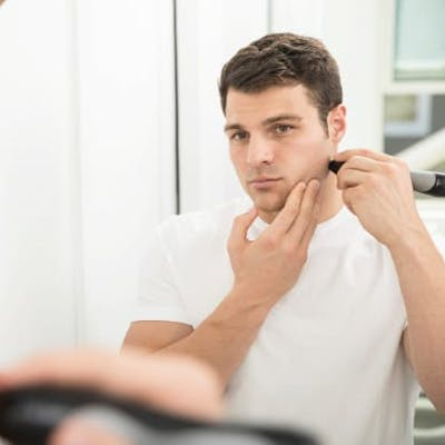 Man using Personal Microderm Man to treat face.