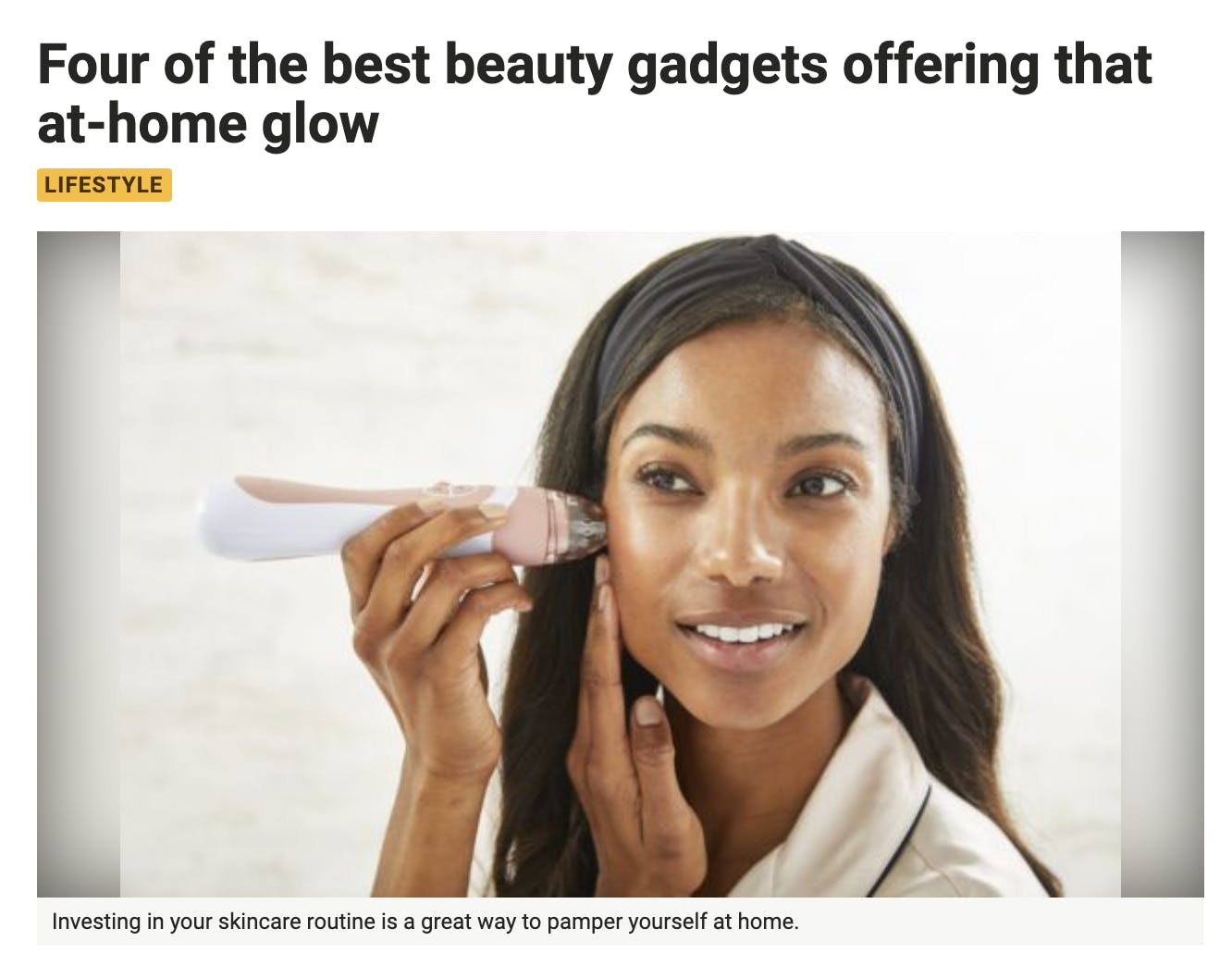 Excerpt from BreakingNew.ie article featuring woman using pink PMD Personal Microderm Elite Pro