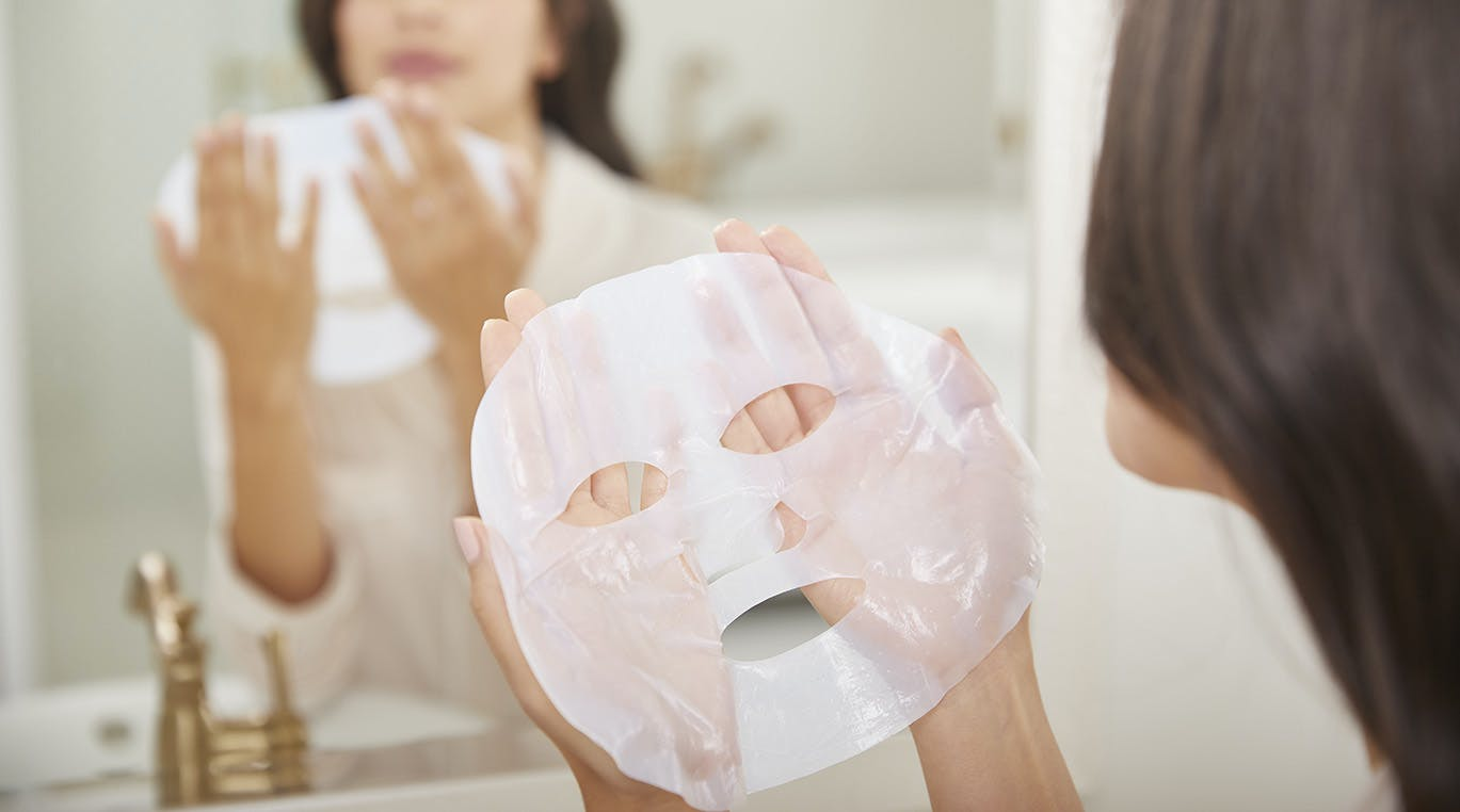 Woman holding sheet mask