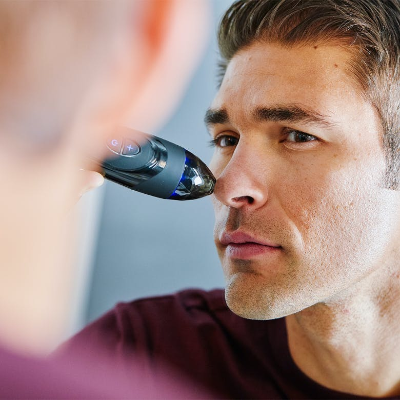 Man using Personal Microderm Elite on nose