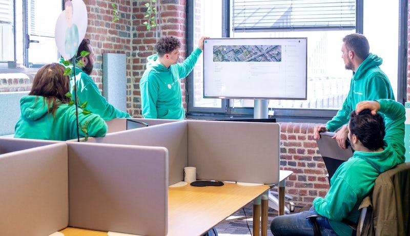 Photo de l'équipe commerciale en réunion