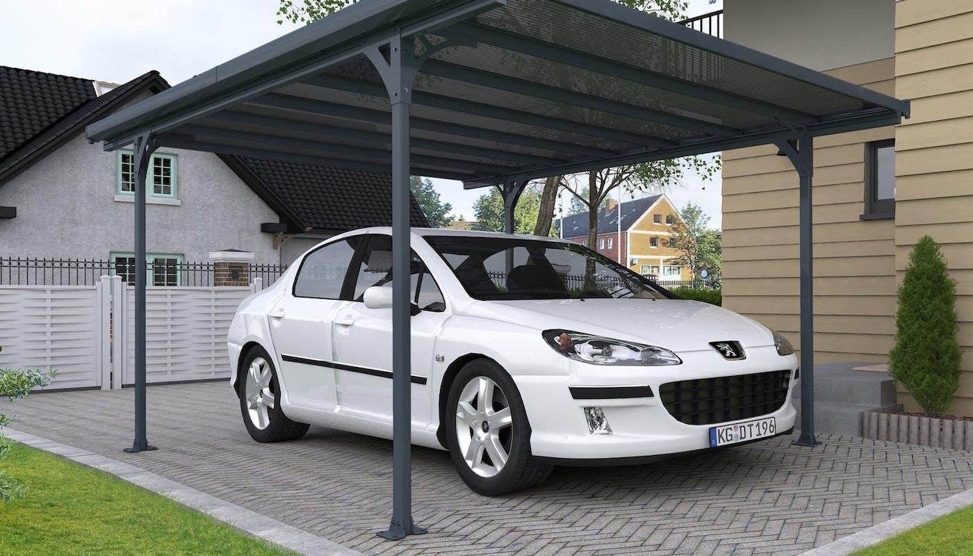 carport à toit plat noir avec une voiture blanche en dessous
