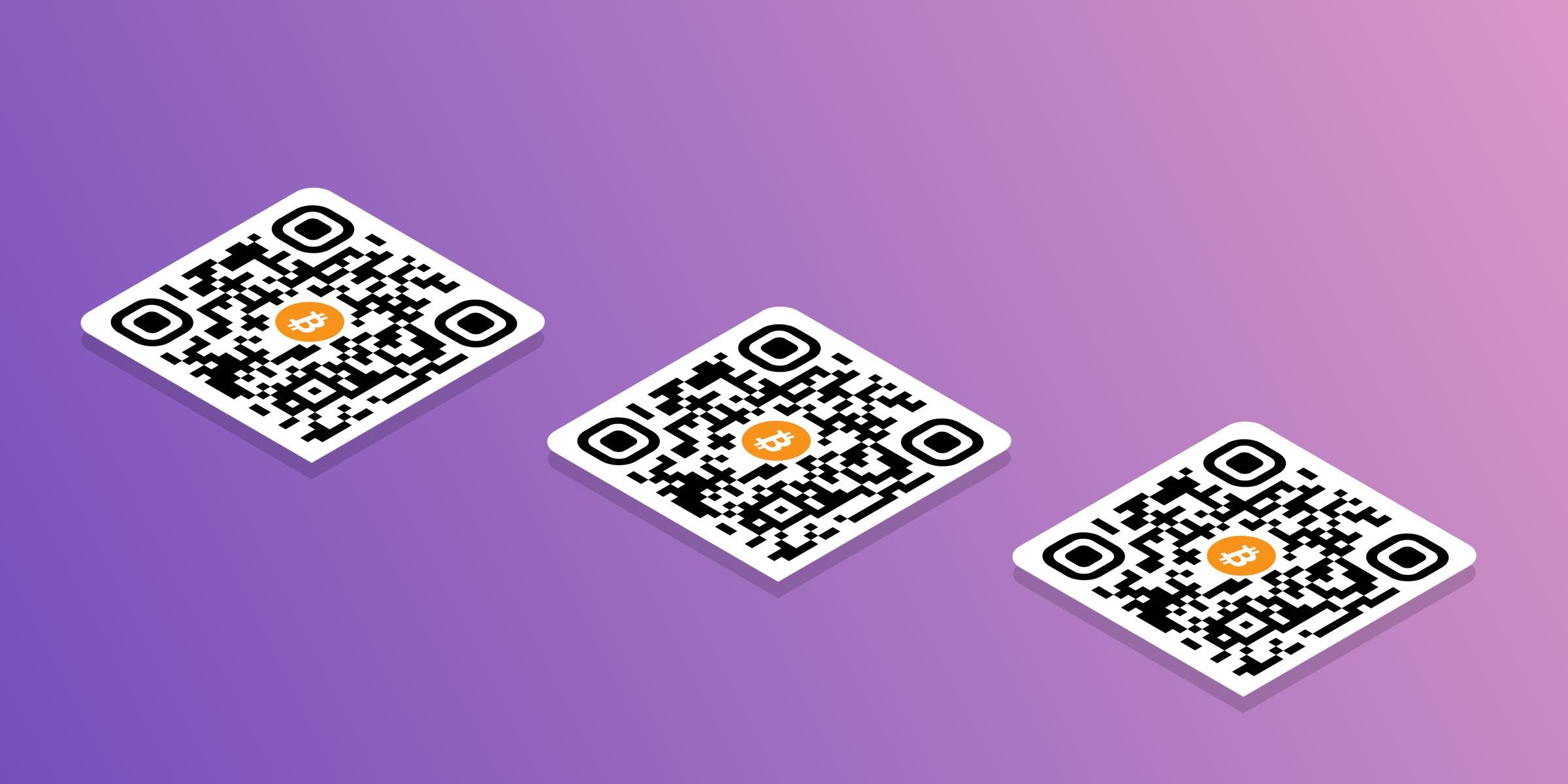 three aligned qr codes with bitcoin addresses on them