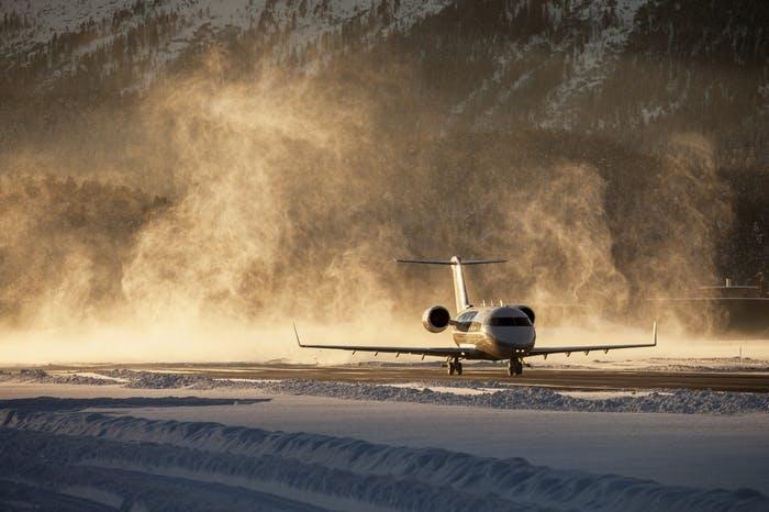 private jet landing on snow