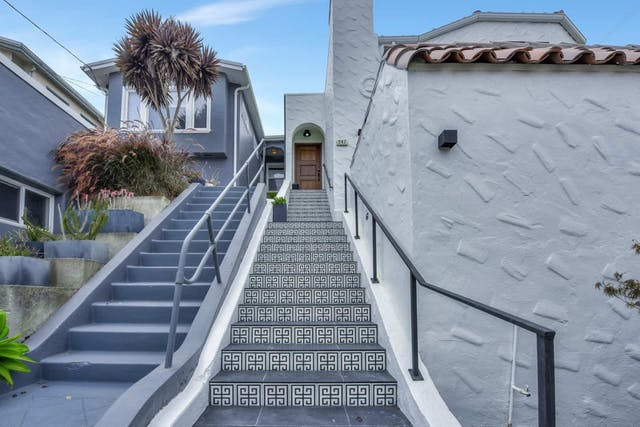 Sunnyside home exterior with stairs