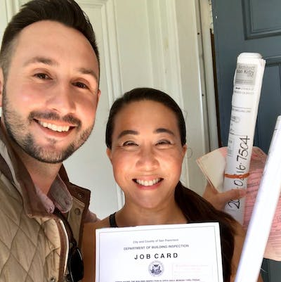 happy homeowner with contract
