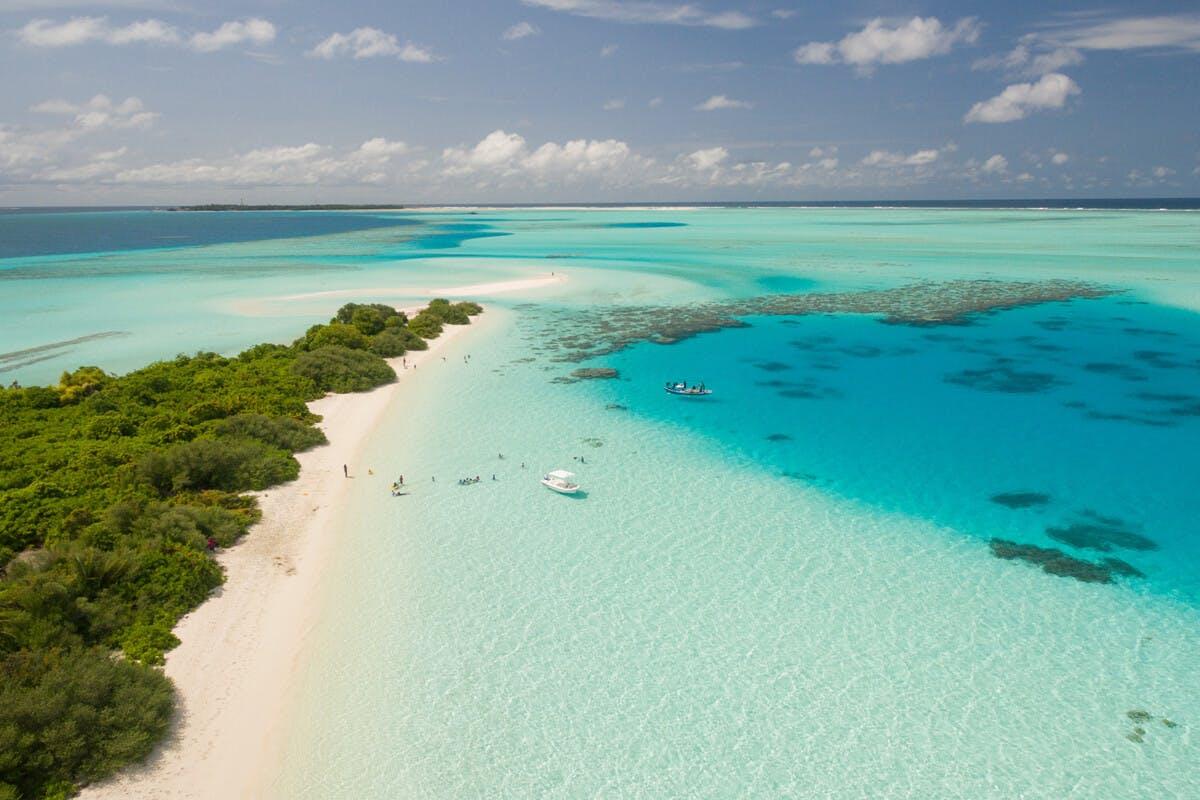 Reisen an tropische Strände sind eine Herausforderung für den Darm