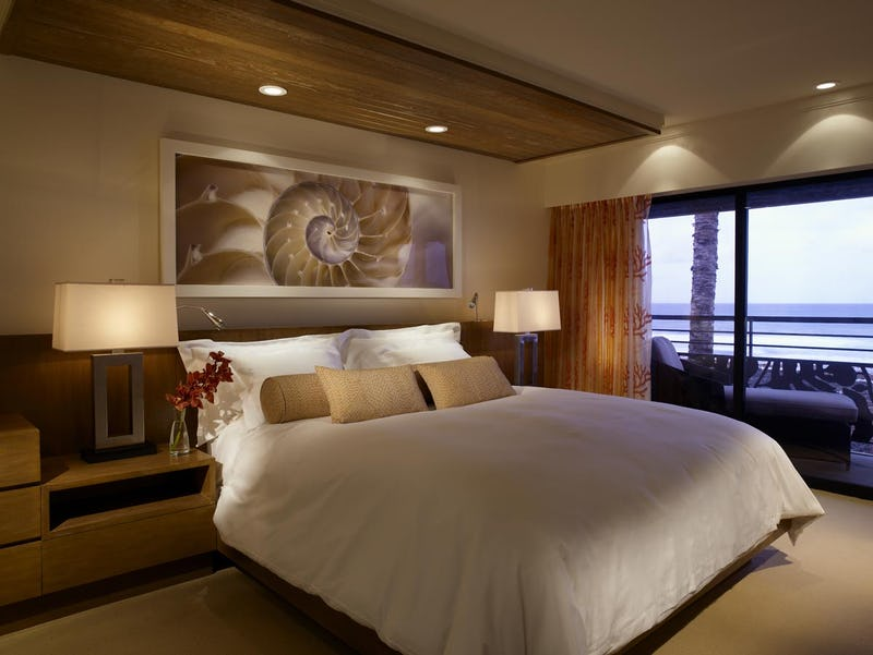 Bed in suite with art and furnishings.