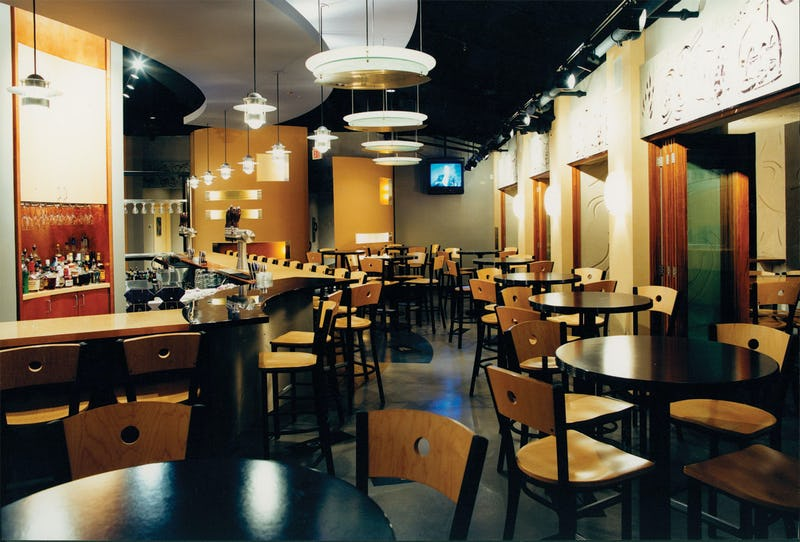 Interior photo of Brew Moon Restaurant & Microbrewery with bar tables and stools