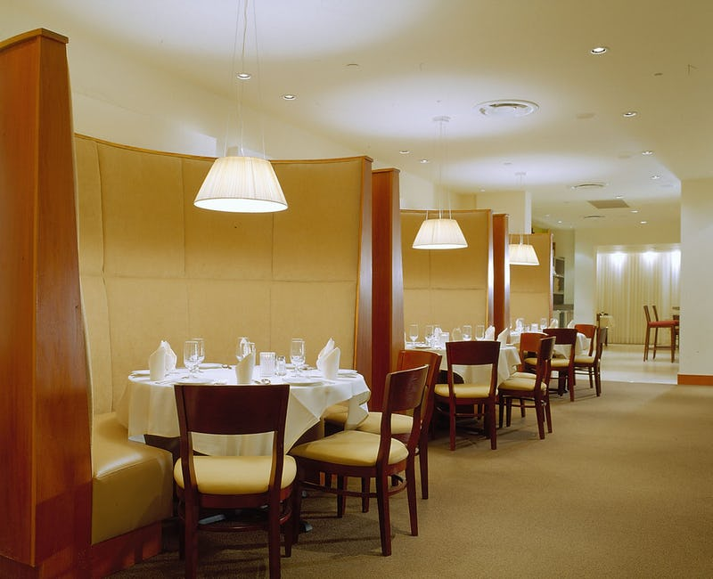 Dining tables with table settings in Assaggio Ristorante