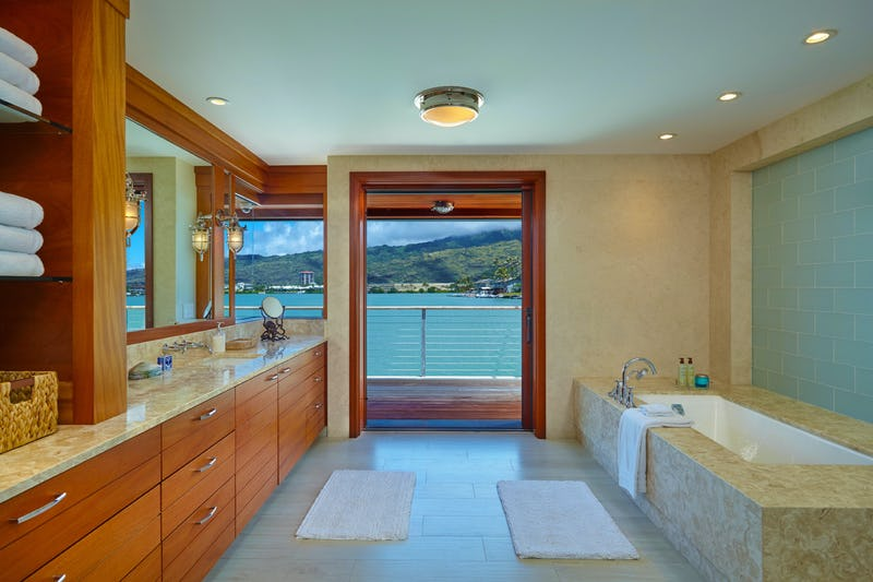 Bathroom with stone tub and doorway to balcony