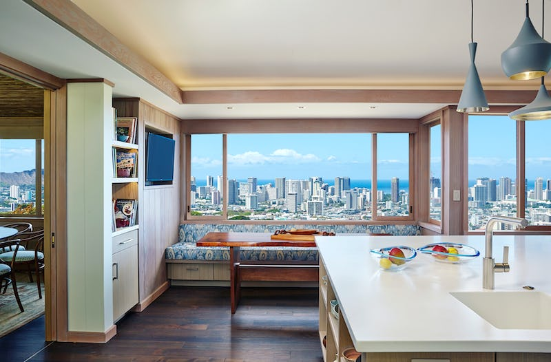 Kitchen and lounge with city view.