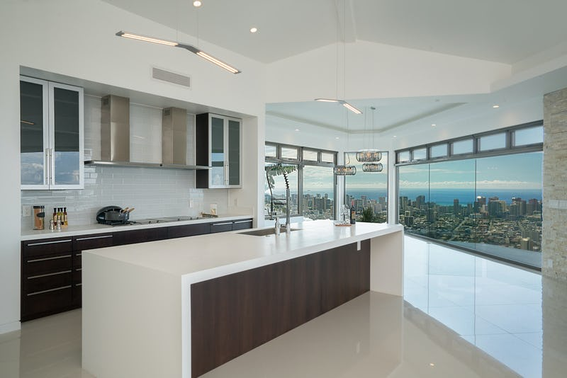 Kitchen counter with city view.