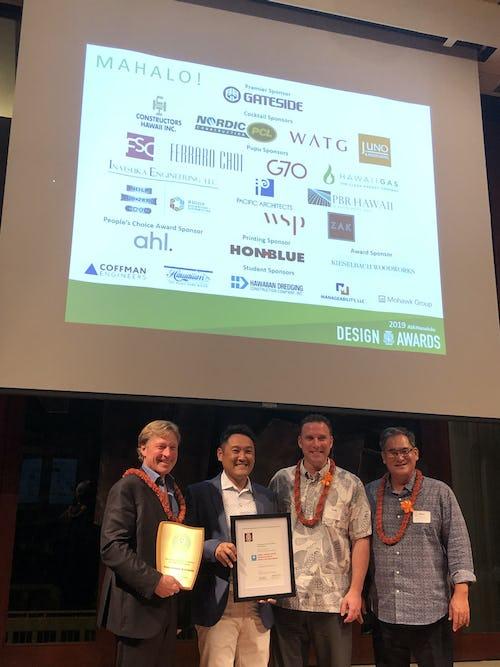 PVA team members post with awards