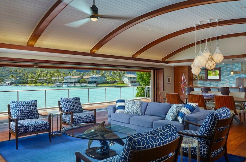 Living room with open access to balcony overlooking ocean
