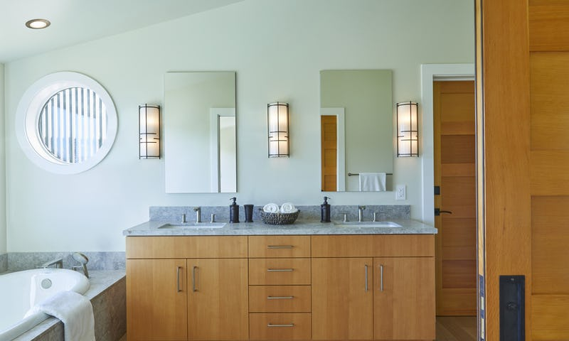 Bathroom with dual sinks and tub