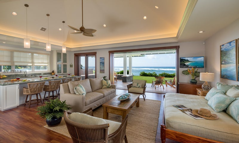 Living room and kitchen photo looking out toward ocean