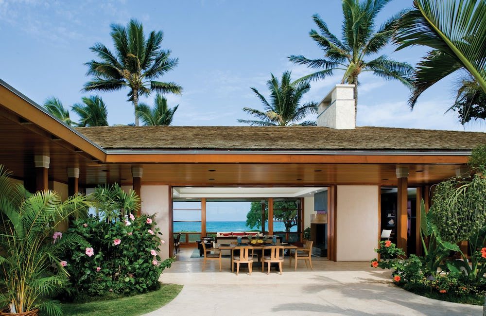 Exterior photo of home with open air dining room