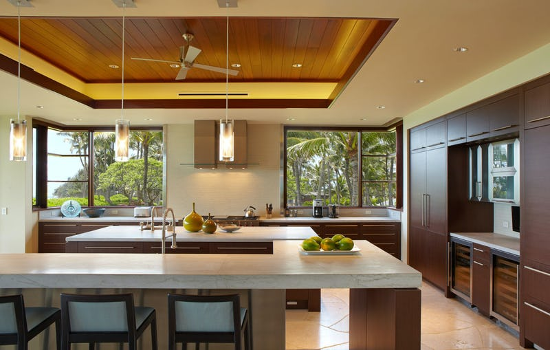 Kitchen with elongated bar with stools