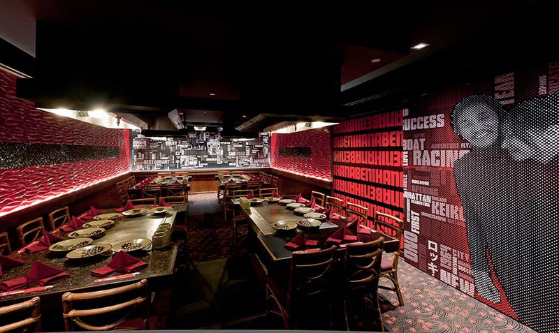 Dining tables at Benihana of Tokyo at Hilton Hawaiian Village with typography-filled walls in the background